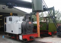the loco sits outside the works next to resident Trangkil No 4