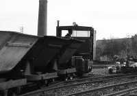 60s Simplex entering the yard with a train of skips.